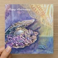 Happy Anniversary card with flowers ,rings and an oytser shell