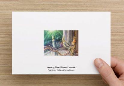 greeting card of cockatiels rear