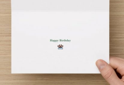centre of happy birthday card with happy birthday greeting