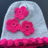 silver and pink flowered adult hat woollen