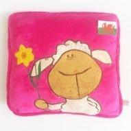 welsh cushion with sheep and daffodil in pink