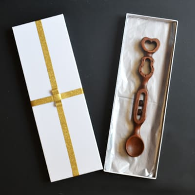 Welsh love spoon with balls and cage and quality gift box. Love spoons for sale.