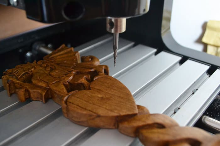 Welsh love spoons engraved. CNC engraving machine. Personalised Welsh love spoons