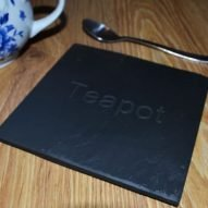 welsh slate teapot stand with engraved letters.