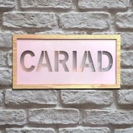 cariad illuminated wall sign